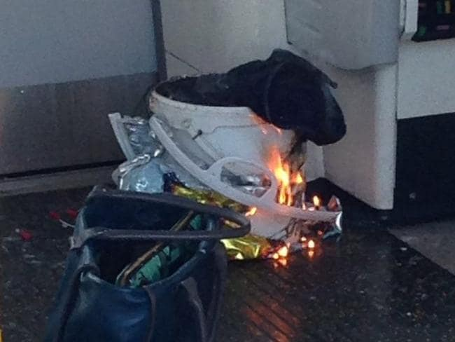 The bucket in a plastic bag believed to have caused the explosion, with protruding wires visible. Picture: Twitter