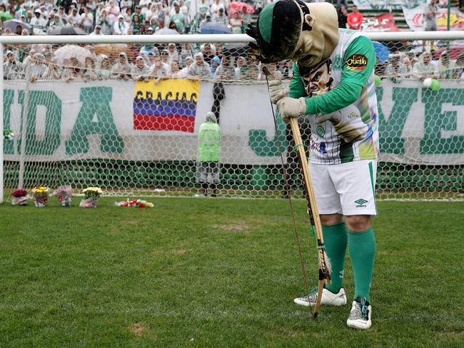 Chapecoense Real's official mascot pays tribute to the players during a funeral at the team's home stadium. Picture: Buda Mendes/Getty Images