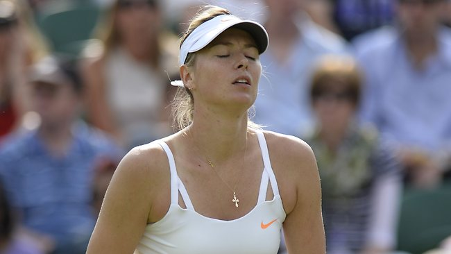 Russia's Maria Sharapova reacts after a point against Portugal's Michelle Larcher De Brito during their second round women's singles match at Wimbledon.