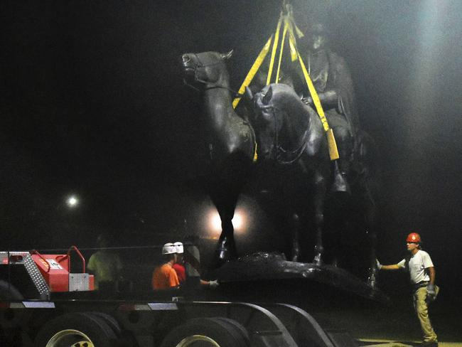 "Workers remove the Robert E. Lee and Thomas J. ""Stonewall"" Jackson monument in Wyman Park in Baltimore this week. Picture: AP"