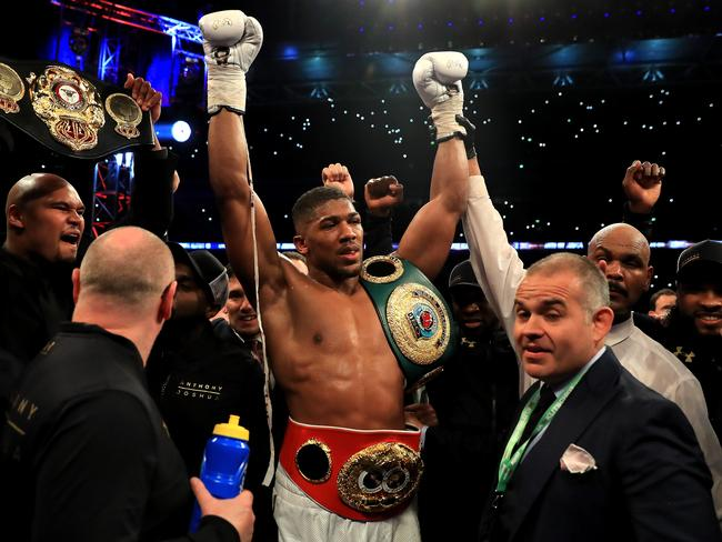Anthony Joshua celebrates after the war. (Photo by Richard Heathcote/Getty Images)