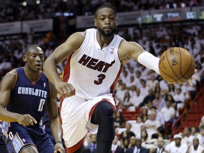 Dwyane Wade has re-signed with the Miami Heat in the wake of LeBron James' exit for Cleveland.