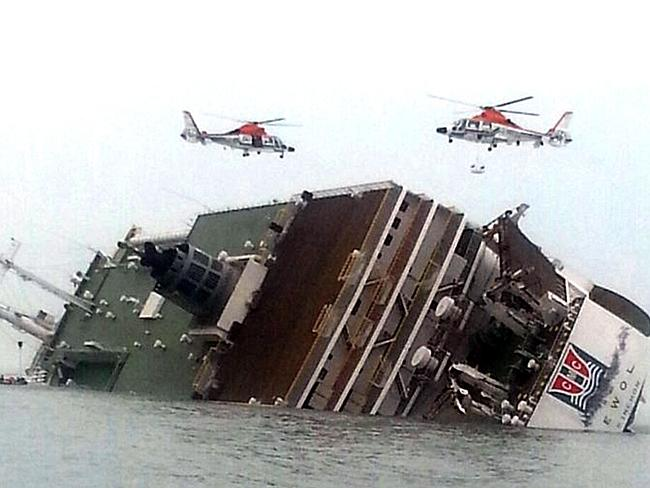Help on its way ... helicopters heading to aid passengers and crew aboard a South Korean ferry sinking. Picture: Yonhap