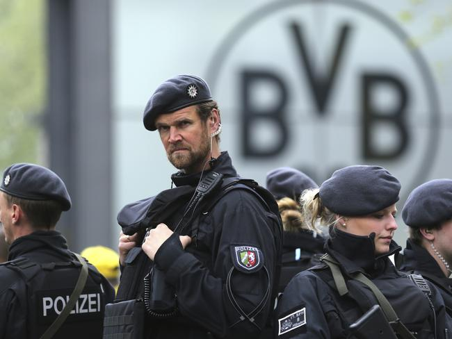 Police guard the entrance of the Dortmund stadium. Picture: AP