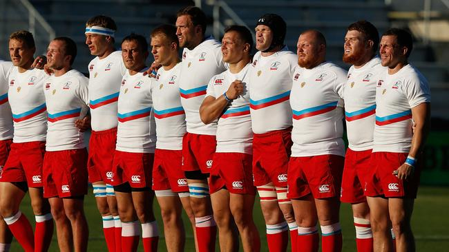 The Russian rugby team stand for the national anthem before playing the USA.