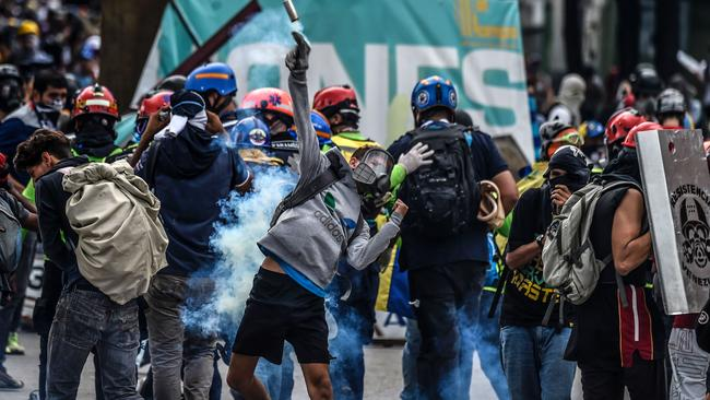 Opposition activists clash with riot police in Caracas. Picture: Juan Barreto/AFP