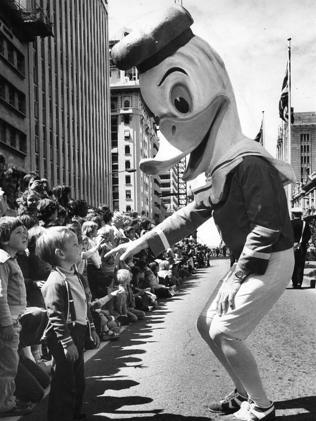 A giant duck either talks to (or terrifies) a small boy at the John Martin's Christmas Pageant in 1977.