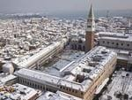 In this aerial image taken Wednesday, Feb. 28, 2018, Venice's St. Mark's Square, northern Italy, is covered by a blanket of snow as freezing weather from a Siberian cold snap persists in large part of the country. Picture: AP