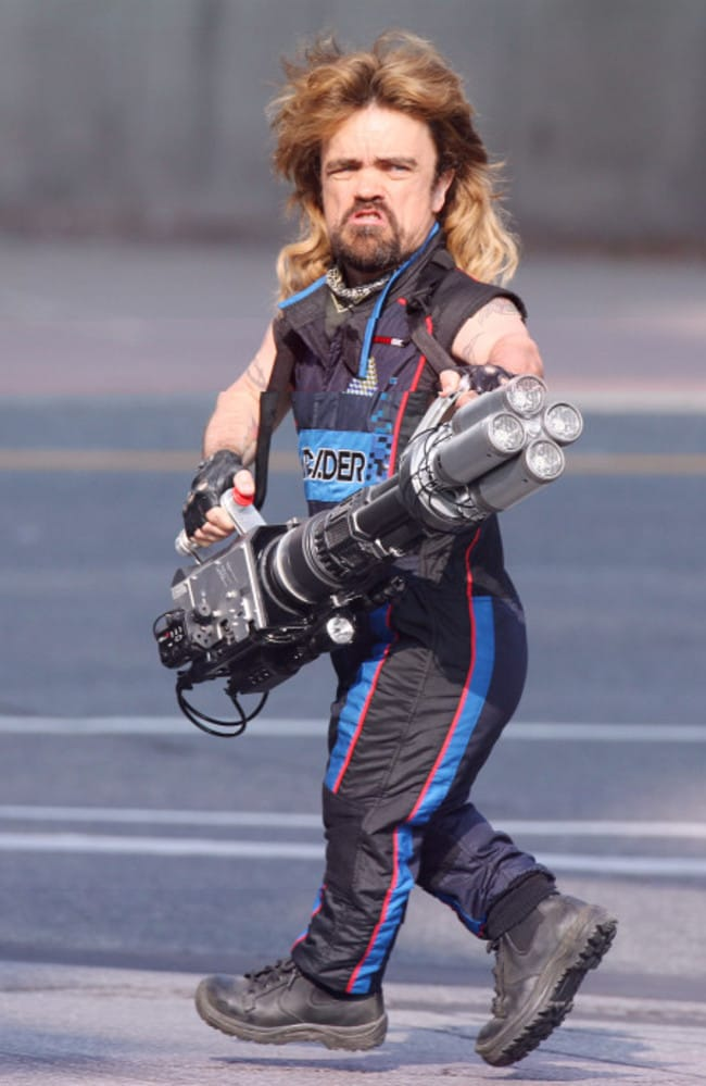 DINKLAGE POWER! The actor is seen holding what appears to be a huge bazooka while filming his new movie Pixels in Toronto. Picture: Pacific Coast News.