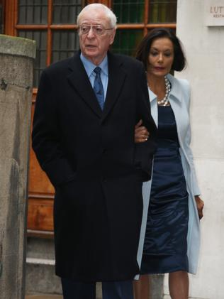 Michael Caine, left, and Shakira Caine arrive at St Bride's Church. Picture: Joel Ryan/Invision/AP
