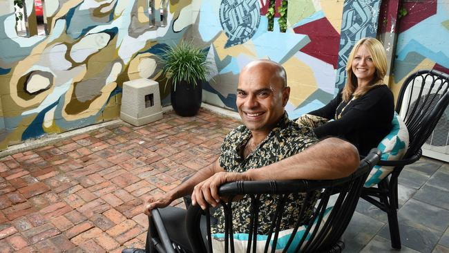 Manik and Sharon Meah with the street art at their Eastwood property. Picture: Roger Wyman