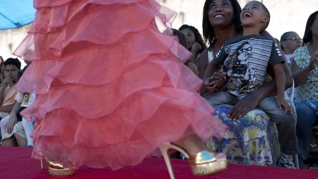 Inmates and their relatives watch female prisoners compete in an annual beauty contest. Picture: AP Photo/Silvia Izquierdo.