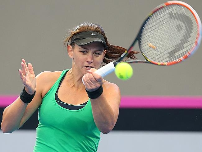 Casey Dellacqua plays a forehand during a training session ahead of the Fed Cup tie between Australia and Germany at Pat Rafter Arena.