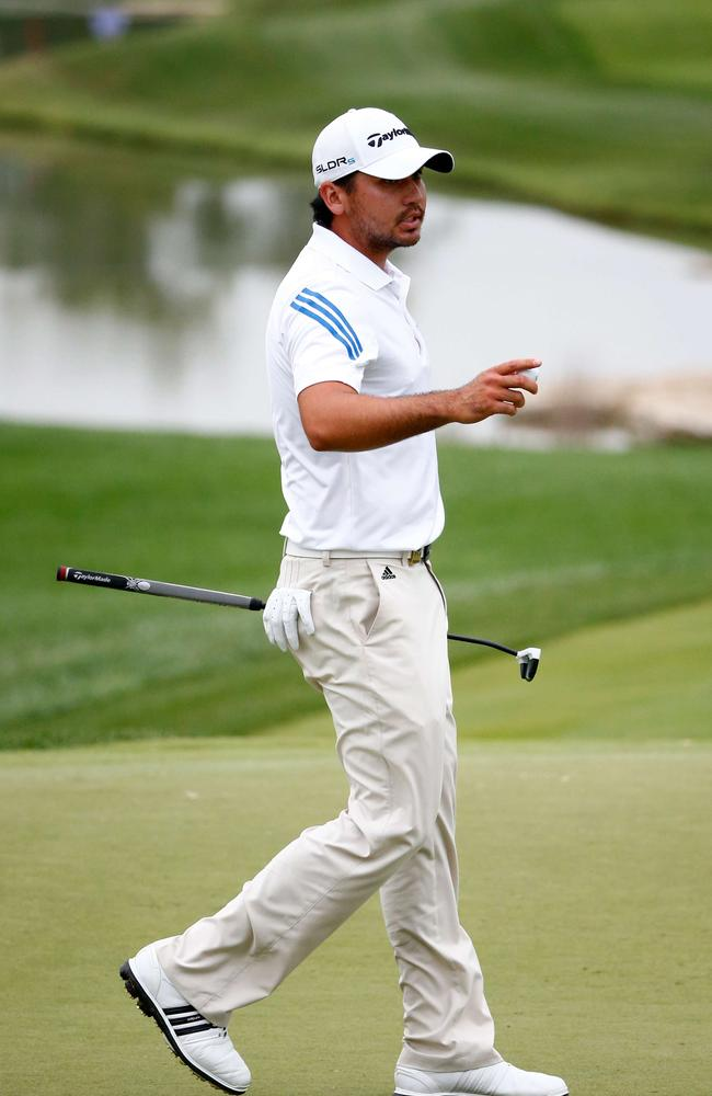 Jason Day thanks the crowd after sinking his putt at the 18th green.