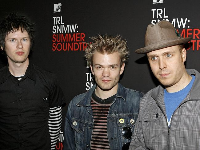 Better days ... Sum 41 band members Cone McCaslin, left, Deryck Whibley, centre, and Steve Jocz, right, backstage at MTV in 2007 in New York. Picture: AP