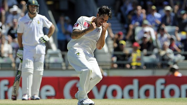 Mitchell Johnson celebrates the wicket of Dean Elgar, out LBW for 0. Picture: Daniel Wilkins