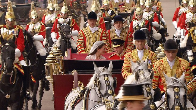 The open carriage ride to Buckingham Palace added a bit of fairytale magic to the wedding. Picture: AP