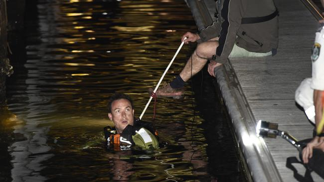 A diver searches an area next to the pier where the man fell. Picture: Gordon McComiskie