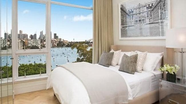 The bedroom has harbour views and mirrored wardrobe