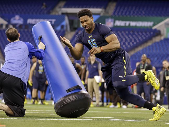 Myles Garrett runs a drill at the NFL football scouting combine in Indianapolis.