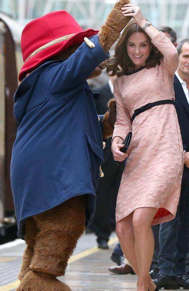 The Duchess of Cambridge dances with Paddington Bear. Picture: Jonathan Brady — WPA Pool/Getty Images