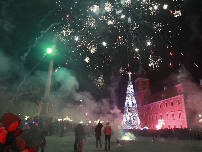 Fireworks above the Royal Castle ... during the New Year's Eve celebrations in Warsaw, Poland. Picture: AP