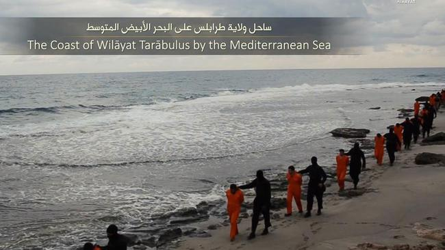IS video ... The Christians are led along the beach. Source: Supplied
