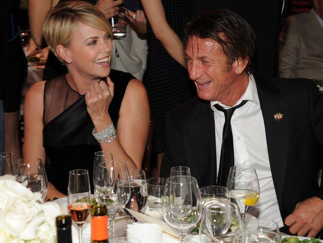 Loved up ... Charlize Theron and Sean Penn attend the 3rd annual Sean Penn & Friends HELP HAITI HOME Gala.