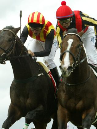 Japanese visitor Delta Blues (right) holds on to narrowly win the 2006 edition.
