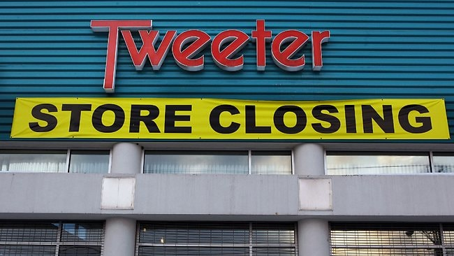 A store closing banner is hung on the vacant Tweeter electronics store in Salem, New Hampshire in 2009. The bankrupt electronics retailer's stock has been confused with Twitter.