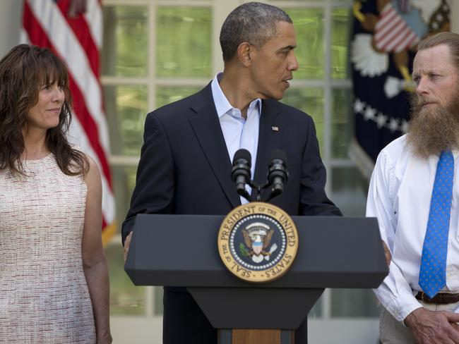 Happy family ... President Barack Obama looks to Bob Bergdahl as Jani Bergdahl, stands at left.