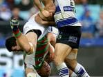 South Sydney's Tom Burgess tackled by Bulldog's Dale Finucane and Michael Ennis during the NRL game between the Canterbury Bankstown Bulldogs and the South Sydney Rabbitohs at ANZ Stadium. Picture Gregg Porteous