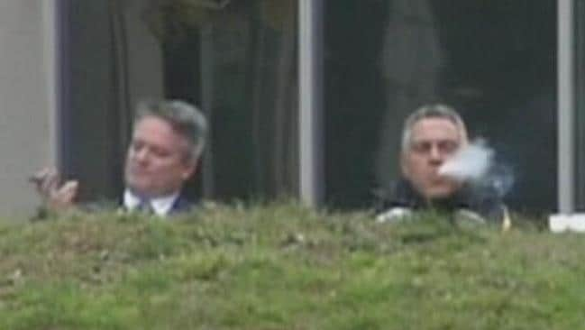 Cigar days ... Finance Minister Mathias Cormann and Treasurer Joe Hockey were pictured enjoying cigars shortly after the budget was announced, but were they celebrating too early? Picture: Twitter / Simon Cullen
