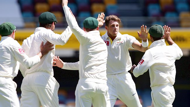 James Pattinson claims the big wicket of Graeme Smith in the second session on day five at the Gabba. Picture: Adam Head