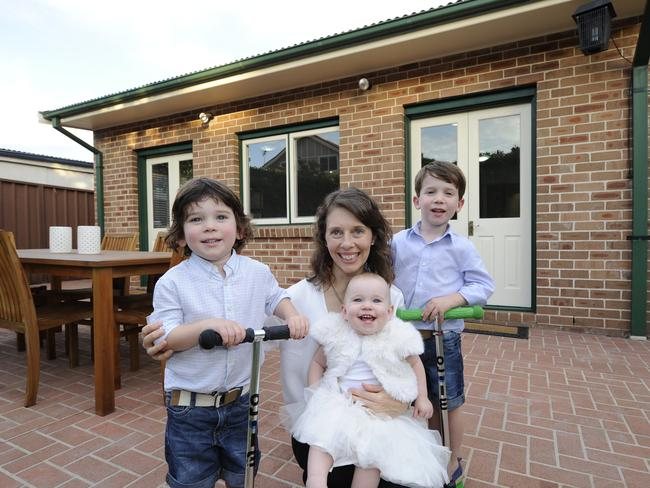 Danielle Butler with children Oliver, 5yrs, Patrick, 3yrs and Caitlin at 24 Weil Ave, Croydon Park. Picture: Craig Wilson