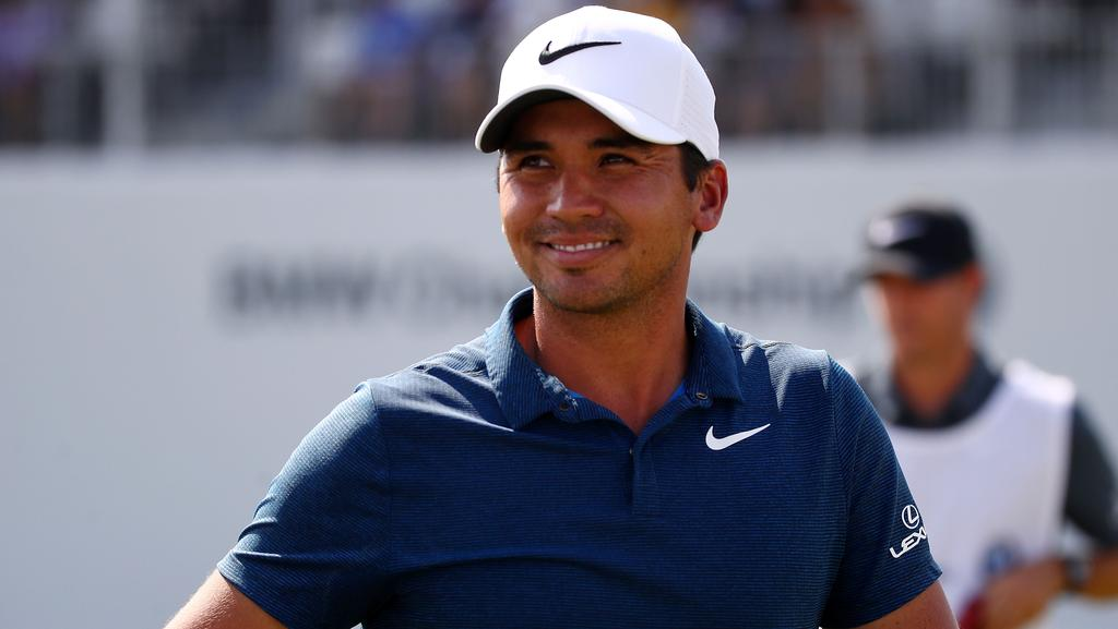 Jason Day of Australia walks off the 18th green after the second round.