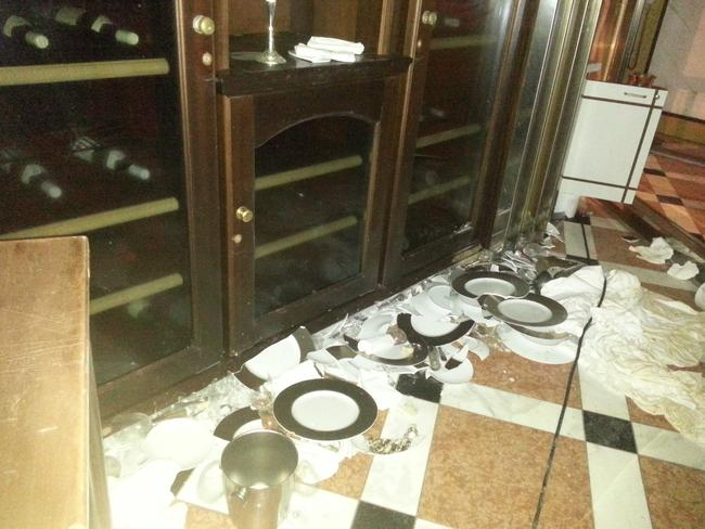 Haunting remains ... Smashed plates and intact wine bottles on the Costa Concordia. Picture: Australpress