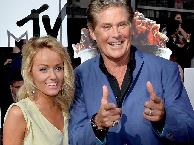 David Hasselhoff and Hayley Roberts pictured at the 2014 MTV Movie Awards. It's fair to say The Hoff is punching above his weight. Picture: Michael Buckner/Getty Images