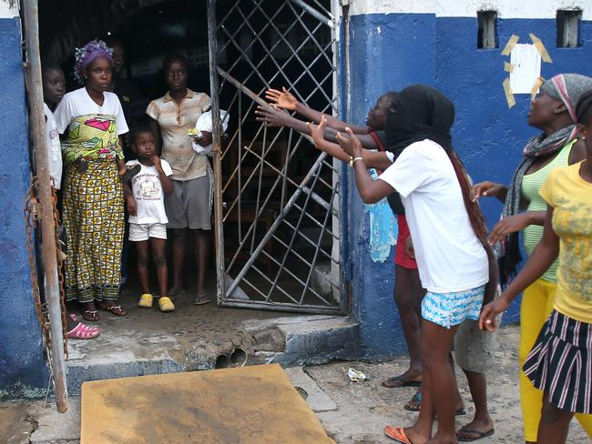 Persuasive ... residents tell patients in an Ebola isolation in Monrovia, Liberia, to escape. Picture: Getty