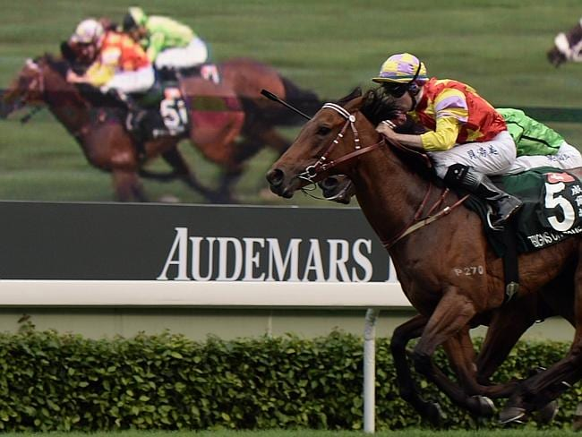 Double impact as Designs On Rome and Military Attack fight out the finish in front of a large screen. Picture: AFP