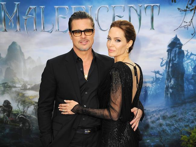 All glamour ... Brad Pitt and Angelina Jolie attend a Maleficent event in London in May. Picture: Getty