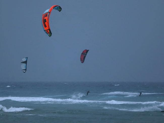 Kite surfers enjoy during the gutsy wind and rain near Currumbin beach, Coolangatta, Gold Coast. Photo: Regi Varghese
