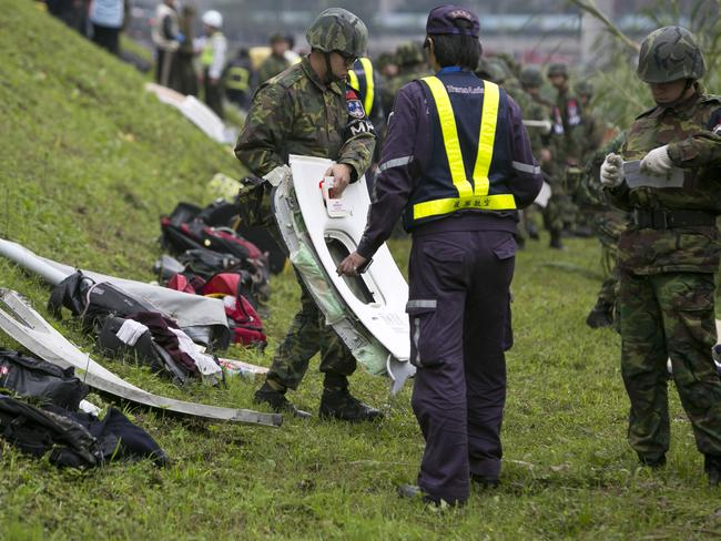 Wreckage found ... a rescue crew carries a window from a TransAsia Airways ATR 72-600 turboprop aeroplane that crashed. Picture: Ashley Pon/Getty Images