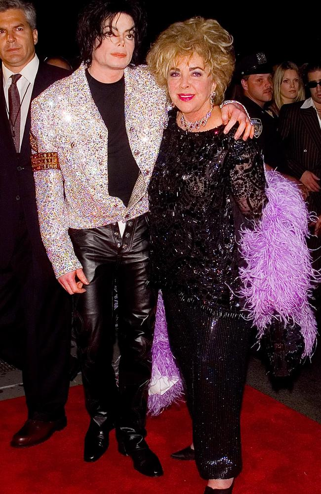 Jackson and close friend Elizabeth Taylor in 2001. The pair will be played by Joseph Fiennes and Stockard Channing in a new comedy. Picture: AP