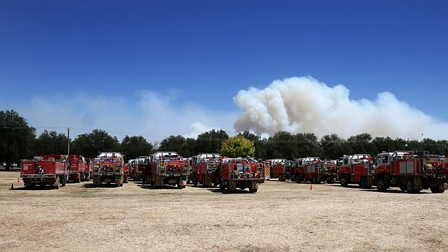 Wallan staging area today, with a plume rising in the background. Picture: Norm Oorloff