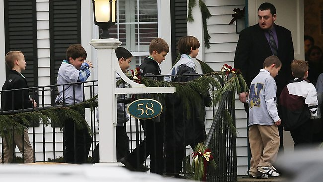 Boys walk to enter Honan Funeral Home before the funeral for 6-year-old Jack Pinto in Newtown Connecticut. Pinto was one of the 20 students killed in the Sandy Hook Elementary School mass shooting. Mario Tama/Getty Images