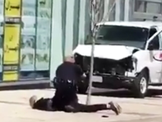 A man believed to be behind the Toronto van attacked that has left 9 people dead is taken into custody by a sole police officer. Picture: Twitter
