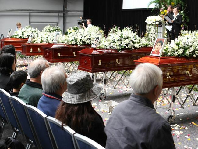 Five coffins lined up at the Lin family funeral at Olympic Park, Homebush in 2009. Picture: News Corp.