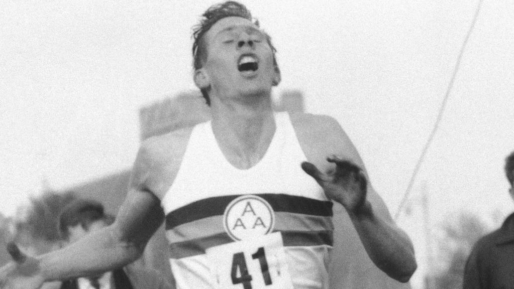 Britain's Roger Bannister hits the tape to break the four-minute mile in Oxford, England. Picture: AP