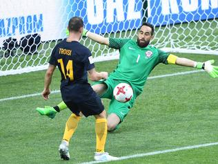 Australia's forward James Troisi scores in the nets of Chile's goalkeeper Claudio Bravo during the 2017 Confederations Cup group B football match between Chile and Australia at the Spartak Stadium in Moscow on June 25, 2017. / AFP PHOTO / Natalia KOLESNIKOVA